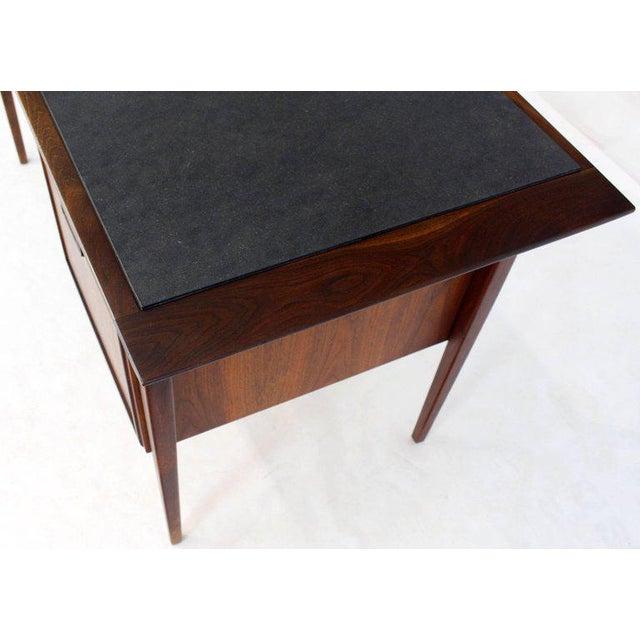 Danish Mid-Century Modern oiled walnut desk with slate top. Beautiful solid walnut tapered legs.
