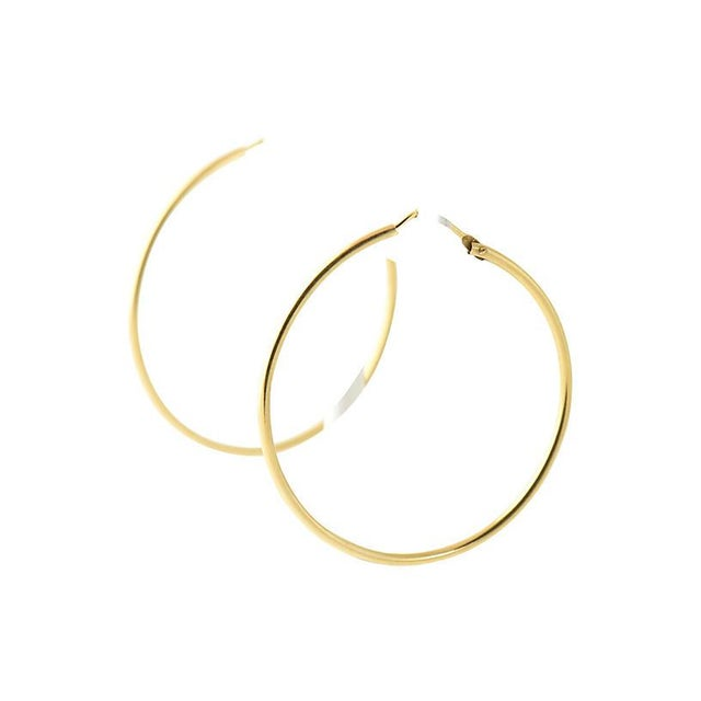 Italian 18K yellow gold hoop earrings with post backs. Marked: 750. Due to the unique nature of this product, all sales...