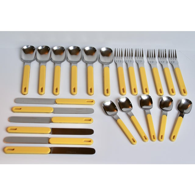 Groovy yellow flatware set with plastic yellow handles. Stainless steel. Marked Stainless Steel Japan. In excellent...