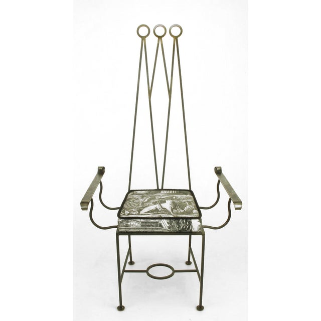 """Set of eight custom designed blackened wrought iron dining chairs. Set consists of """"king"""" and """"queen"""" chairs and six..."""