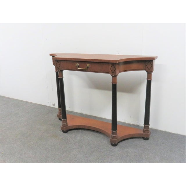 French Empire style console table made by Hekman, Cherry wood with ebonized columns and diamond accents, single drawer...