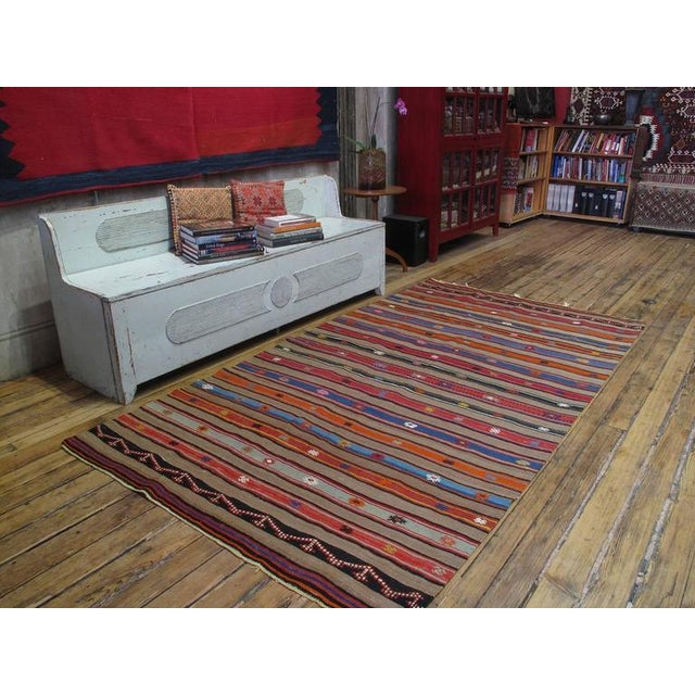 """A lovely old tribal flat-weave from Southwestern Turkey, woven in alternating bands and decorated with motifs in """"jijim""""..."""