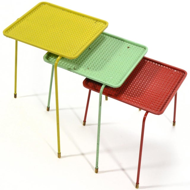 "A beautiful set of three ""Soumba"" nesting tables by Mathieu Matégot in yellow, red and mint green. The table tops have a..."