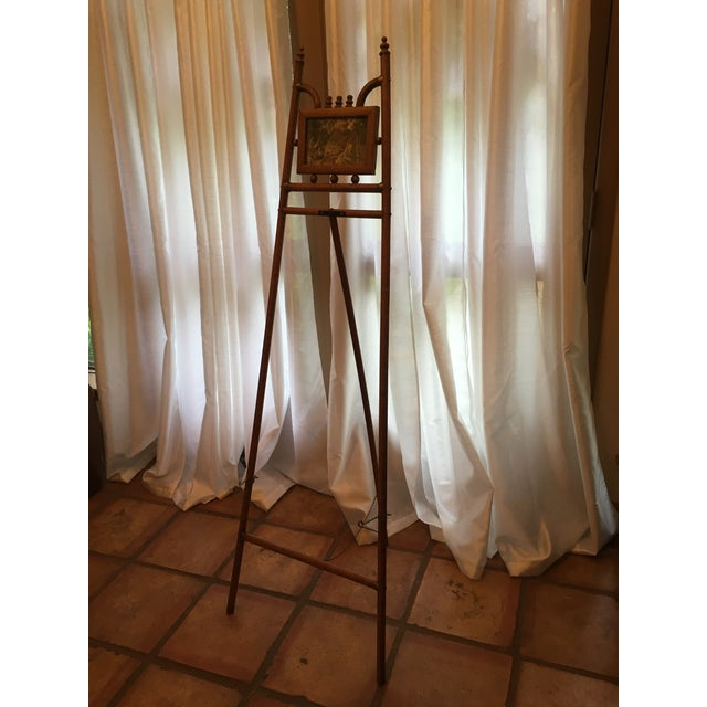 Bamboo easel with brass picture stand and decorative top. Stick and ball decor Picture in middle, but a mirror could...