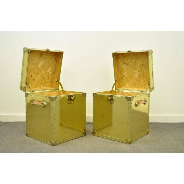 Very unique pair of vintage brass clad trunks or side tables made in the USA by The Luggage Gallery. The pair features...