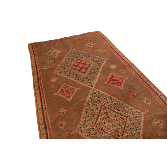 This Senneh kilim is delightful with pops of red and blue in a wonderful diamond pattern. An agreeable beige field is...