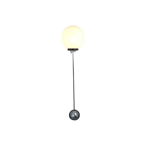 Chrome floor lamp with a thick plastic globe top attributed to Robert Sonneman, circa 1960. Original wiring; takes a...