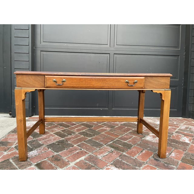 Brass embellished mahogony mid-century desk with drawer from Lane Furniture. Robust design with subtle detailing.