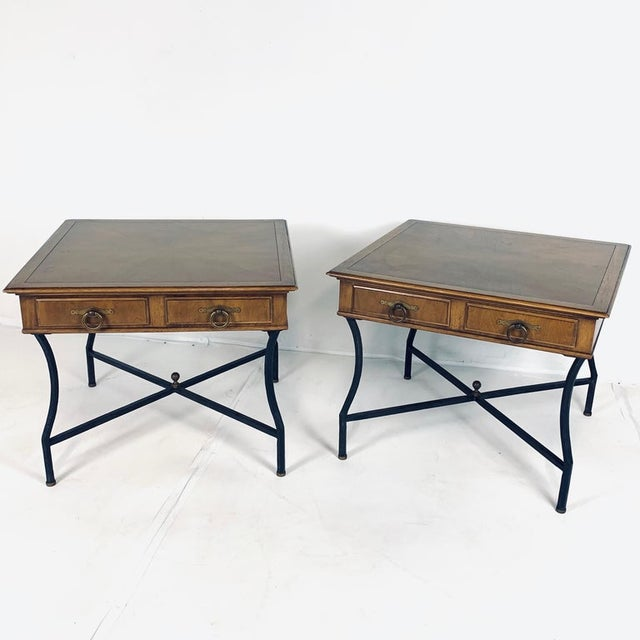 Amazing pair of Tomlinson End Tables. Walnut case top with 2 drawers. Decorative wrought iron base with brass detailing....