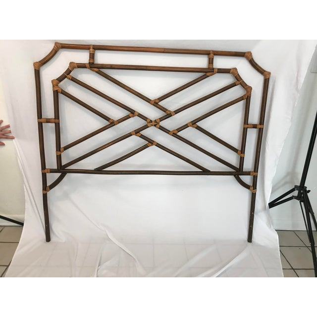 Fabulous vintage bamboo headboard with Chinese Chippendale pattern and pagoda top. There are two pictures to demonstrate...