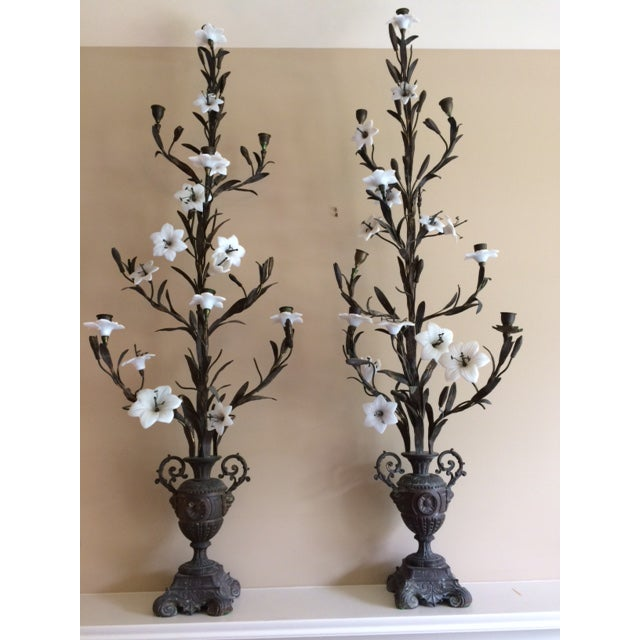 Lovely pair of tall antique French altar candelabras. With intricate detail of opal glass flowers and bronze metal.