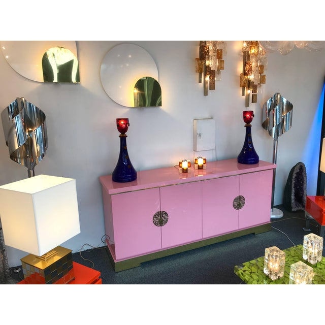 Sideboard buffet or credenzas in light pink lacquer lacquered, brass base and doors elements by Maison Jansen Paris. In a...