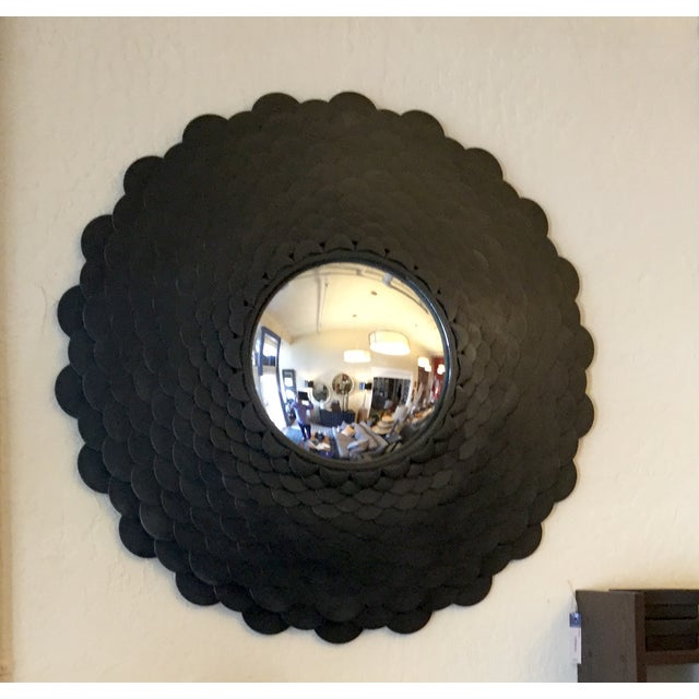 """This elegant piece is a testament to true craftsmanship.T he """"scales"""" in this mirror's frame are individually attached in..."""