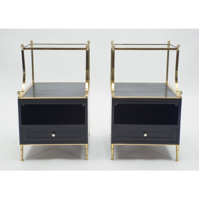 This rare pair of two-tier end tables or side tables by French house Maison Charles was created with black varnished...