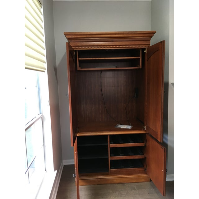Hooker Furniture entertainment center. Can fit TV of size H33xW38xD21. Movable lower shelves. Power outlets for both upper...