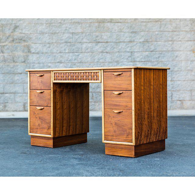 Lane Perception 5 drawer desk. Made of walnut and sits on a plinth base. Drawers feature sculpted lip pulls and middle...