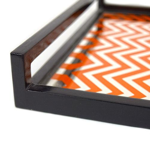 Orange rectangle mirror chevron tray from Waylande Gregory.