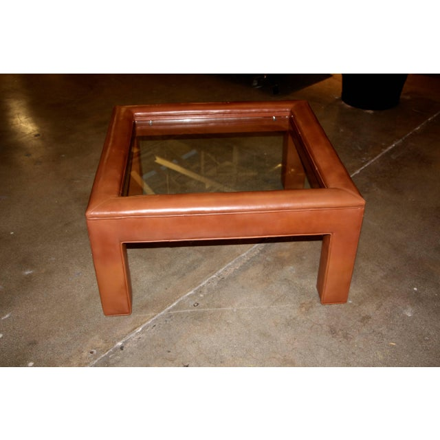 A very pretty brown leather wrapped table with a glass insert. Nice stitching and detail.
