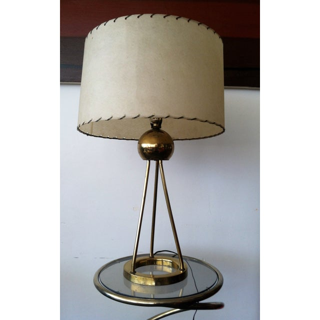 Smooth and sassy brass Nessen table lamp with Atomic Age chic. Iconic lighting for mcm decor. Uses standard bulbs, not...