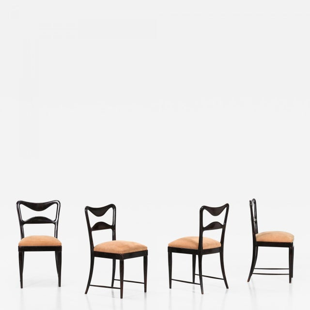 Set of table chairs by osvaldo borsani from the 40s. The seats are made of mahogany wood and covered for the seat, in...