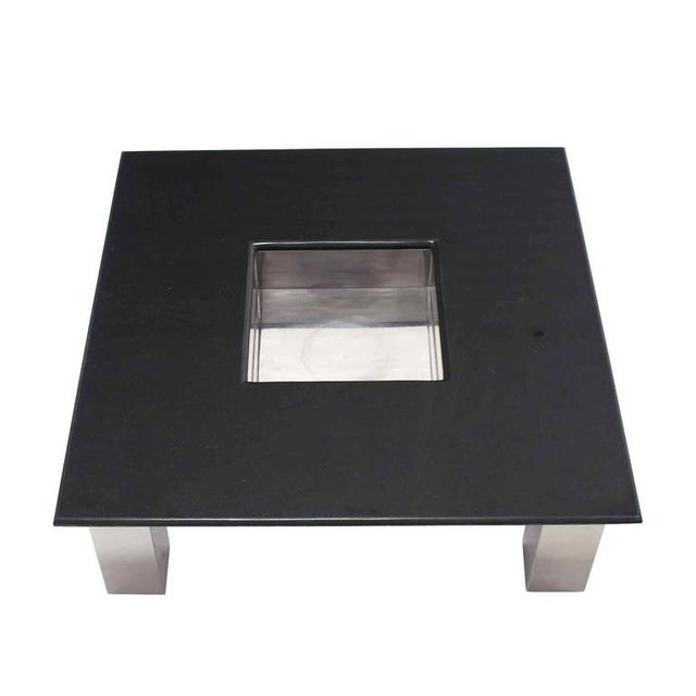 Granite top square coffee table on stainless steel legs. Measures: 42'. Made in the mid 20th century.