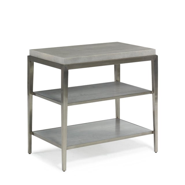 The Lund Rectangle Side Table The Lund side table is a combination of metal framing in a white bronze finish with a wood...
