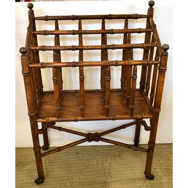 This faux bamboo canterbury magazine rack with brass ball finials and casters is great for it's original use to hold...