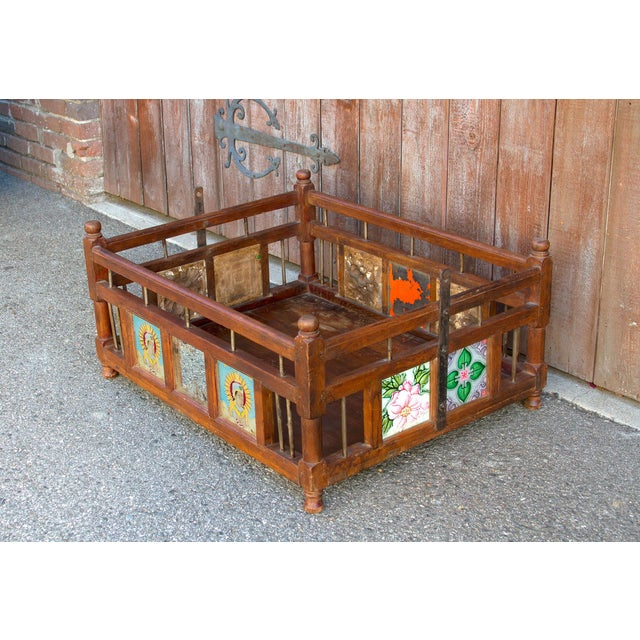 Re-purposed as a coffee table, this charming piece was originally a swinging baby cradle, its adorn with bright and bold...
