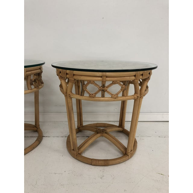 This pair of vintage rattan and reed round side tables with glass tops are the perfect pair for your beachy, BOHO, or...