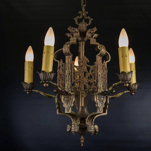This late 1920's American five light chandelier features intricate openwork panels in the Italian Renascence style. Each...