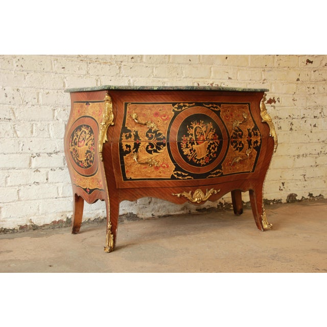 "Offering a rare and important antique two-drawer bombe shaped Louis XV French commode signed ""JF-Oeben"". This commode..."