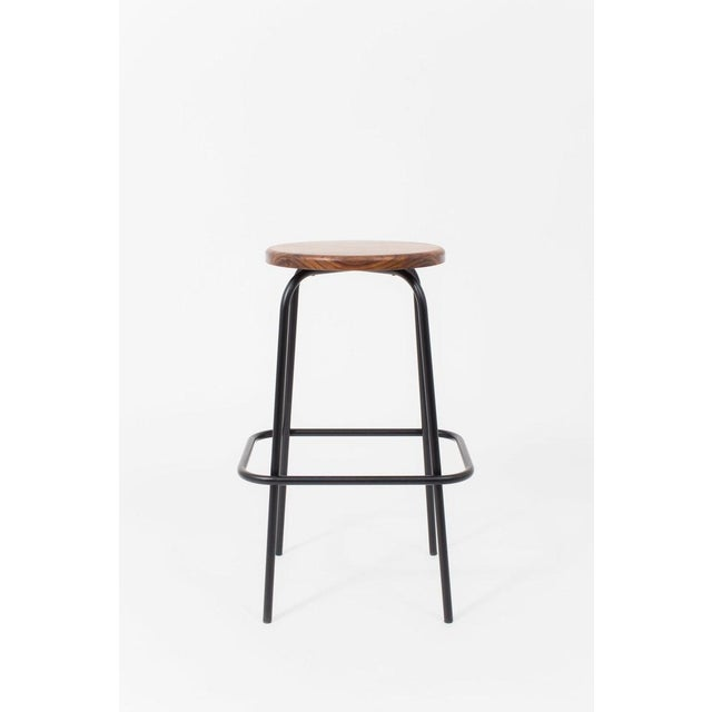 These walnut-seated stools were adapted from our tubular-steel barstool design for Flora Bar's sister restaurant, Café...