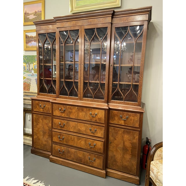This Breakfront cabinet was a custom-made piece and is in beautiful condition. The size and burled wood mahogany make it...