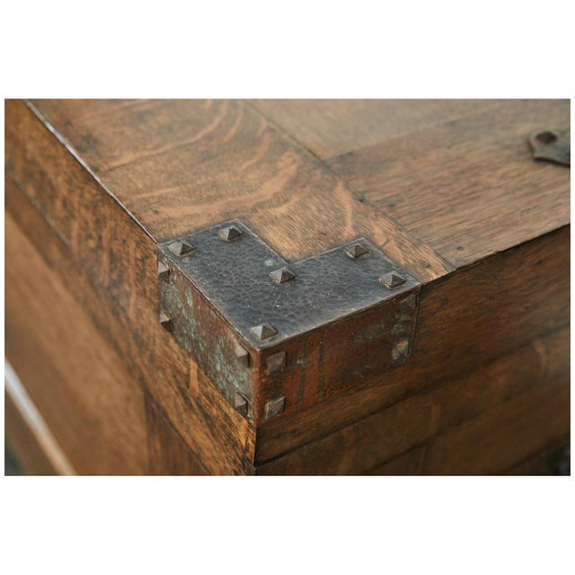 This trunk from the early 20th century is a great example of the arts and crafts movement with ironwork and simple lines.