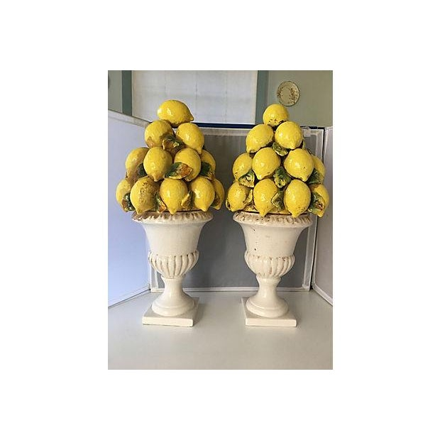 Pair of pottery lemon topiaries. One leaf has a small chip. Large scale pieces. No makers' marks.