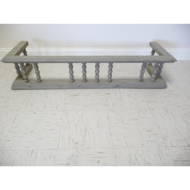 Antique solid oak fireplace surround fender with a distressed gray hand painted finish - lightly distressed in Annie Sloan...