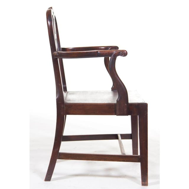 A handsome pair of provincial English mahogany Chippendale arm chairs made in the 18th century. (see 2 pair of matching...
