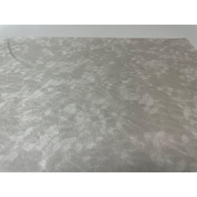 This Cloudy grey/beige smooth face wallcovering is perfect for many different areas. Manufacturer: MDC Made Between:...
