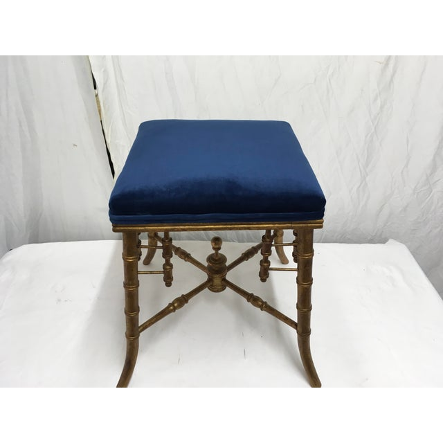 19C gilt wood faux bamboo stool. Newly upholstered with a blue velvet fabric.