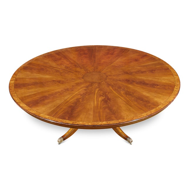 This exceptional round dining table is a masterpiece of fine British craftsmanship. The piece is distinguished by the...