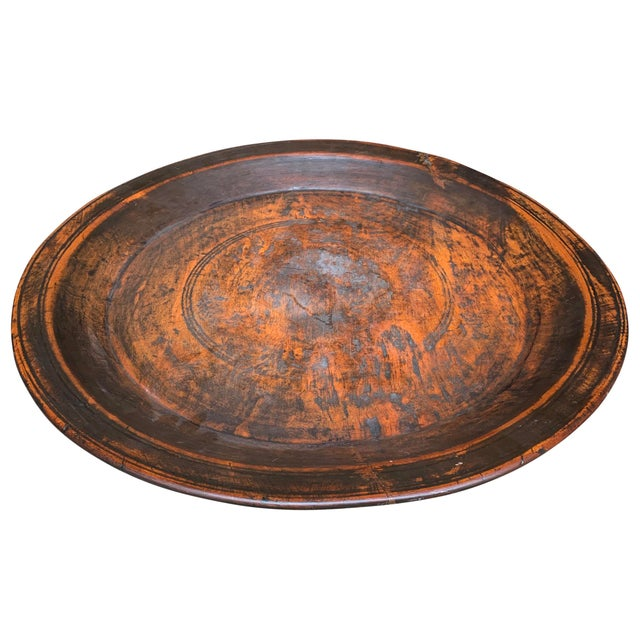 A wonderfully large 19th century turned wood tray with a beautiful patina, and a smooth finish. The reverse side shows...