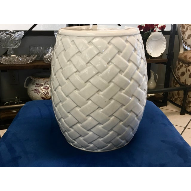 Glazed white garden seat with handles. Crafted with a crisscrossing basket design.
