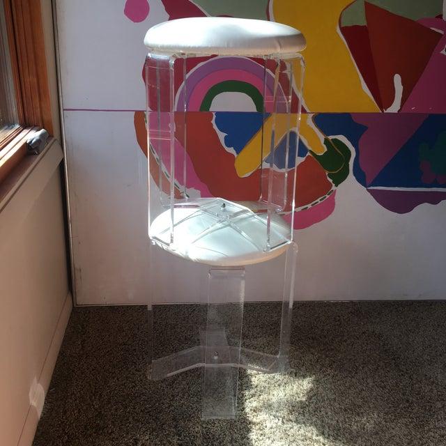Unique pair of Lucite stools with original vinyl cream fabrics.