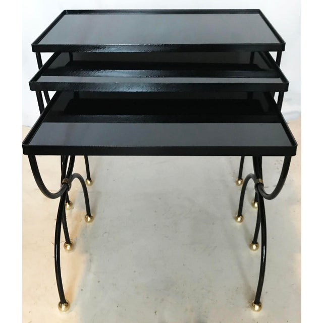 Very Elegant Set of 3 Nesting Tables by Jean Royere Dimensions : 1)21 inches L, 12 inches W,18 inches H 2) 19 inches L, 12...