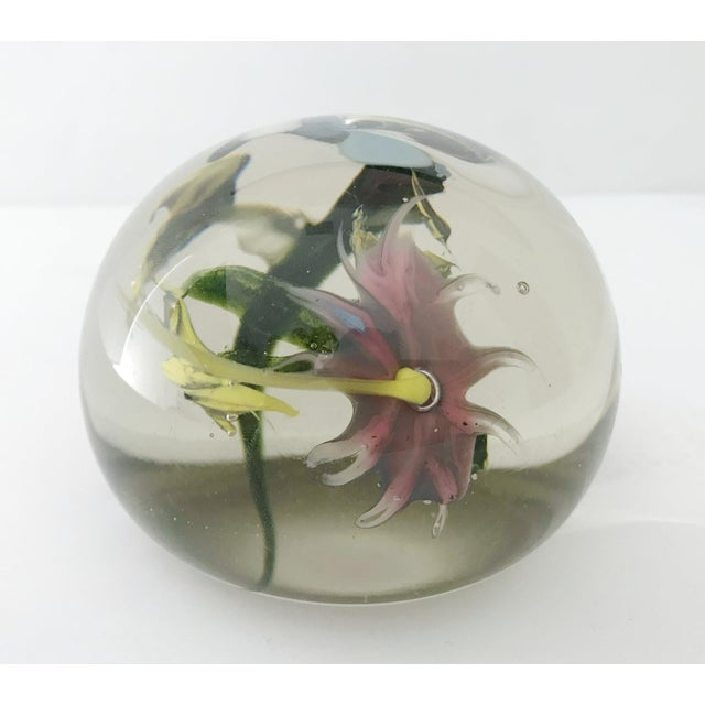 Vintage Italian Murano glass paperweight hand blown with multicolored flowers and leaves, made in Italy, circa 1960s...
