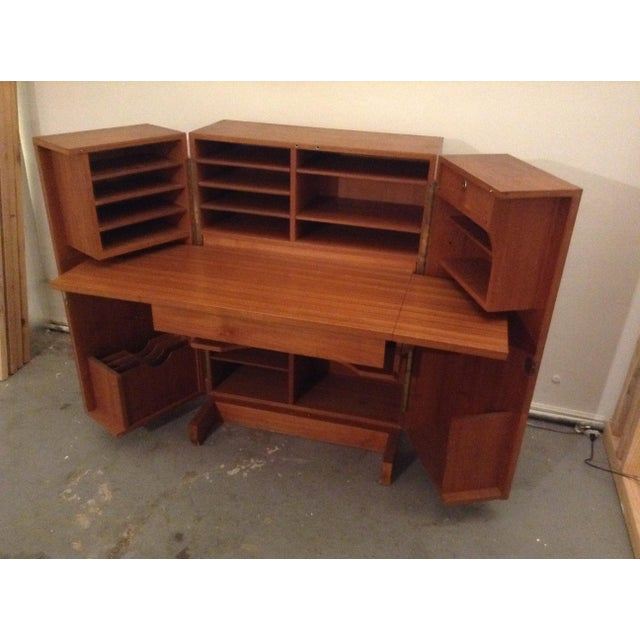 "A 1970's folding ""Magic Box"" secretary desk with numerous adjustable shelves and cubbies. A 1950s danish design this piece..."