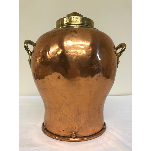 Brass and copper container. Very sturdy - 24lbs! Has a spout that may have been added at some point after production....