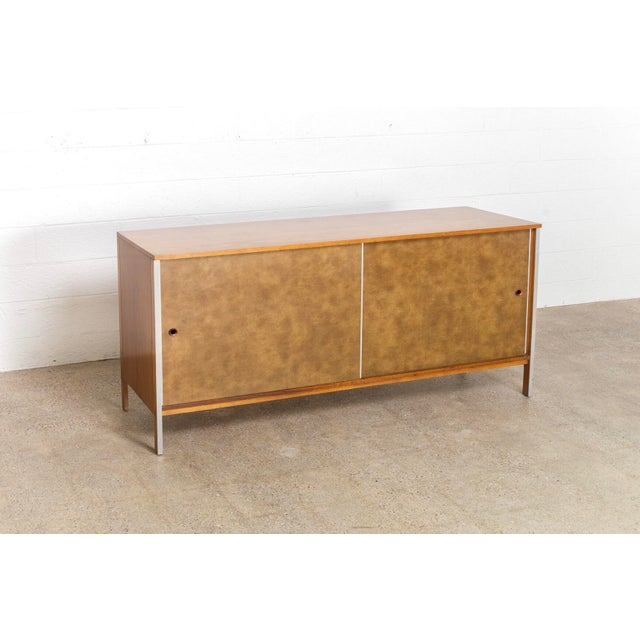 This vintage mid century modern Paul McCobb walnut credenza was produced by Calvin Furniture circa 1960. Part of the...