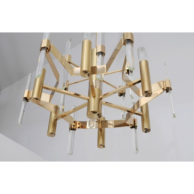 We love this original Sciolari Brass and Glass chandelier. These beautiful modern, geometric spear fixtures will add a...
