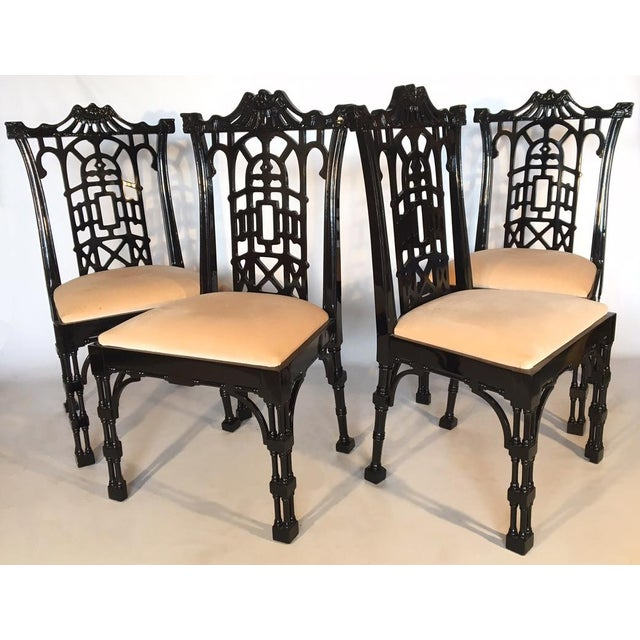 Set of 4 fabulous Chinese Chinoiserie dining chairs in gloss black. Ornate pagoda style detailing and high gloss finish....